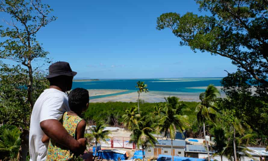 Jona Ratu and his daughter survey the channel dug into the reef on Malolo Island by the China-linked company Freesoul. Photograph: Rob Rickman/The Guardian