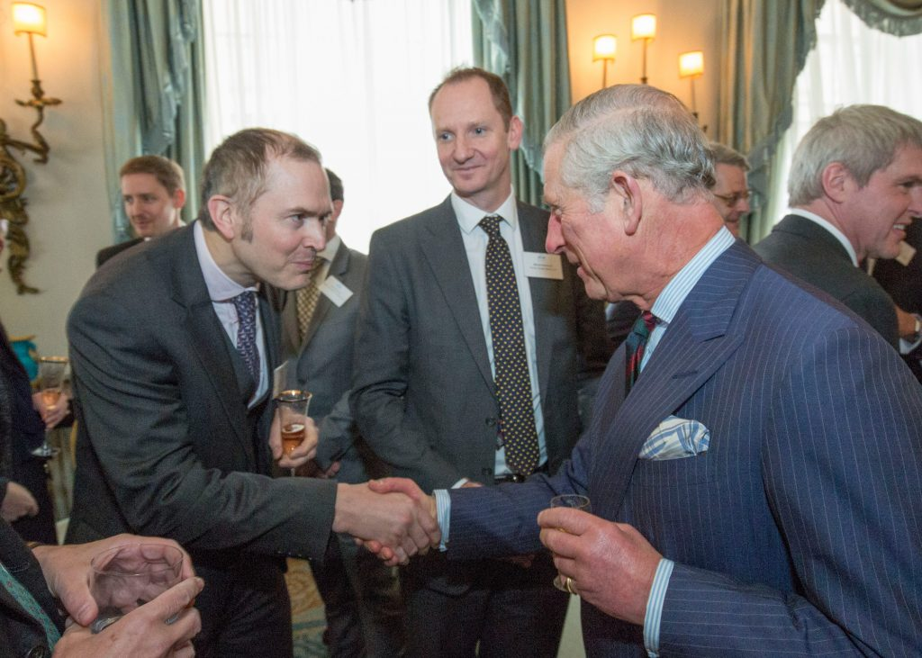 justin-neal-meeting-prince-charles-at-elf-anniversary-reception-calrence-house-241116