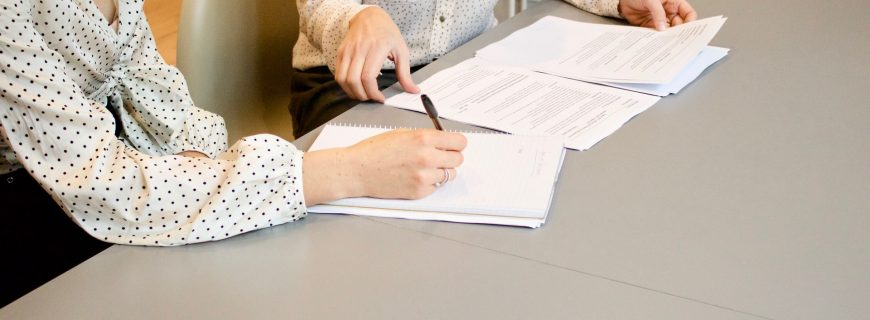 people signing documents